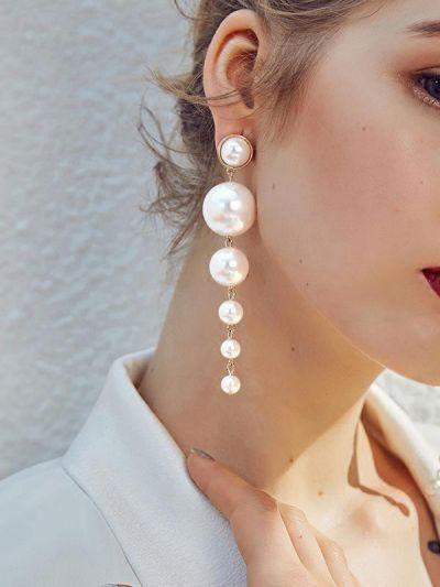 Elegance is a deadly weapon- white pearls statement earrings