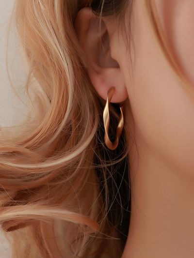 The Subtle Affirmation Golden Twists Hoop Earrings